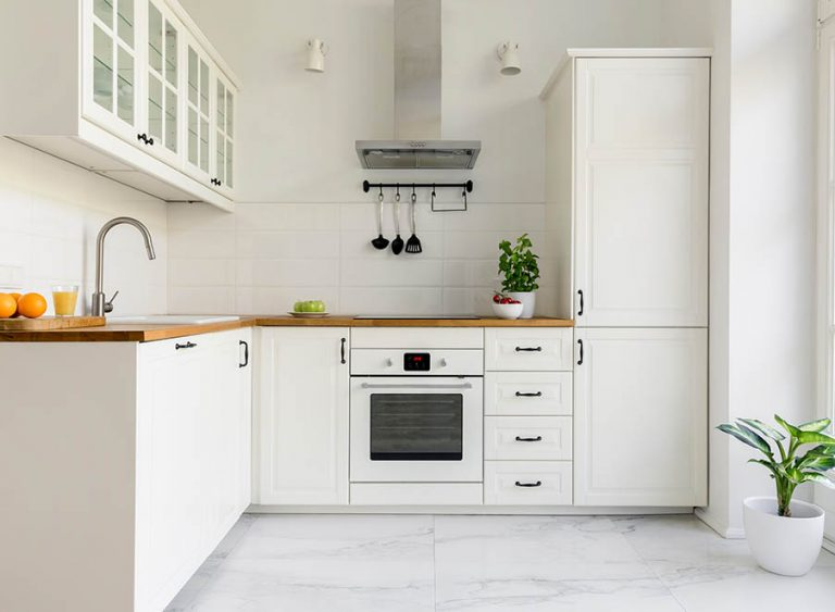 Property Improve Edinburgh small kitchen with white and wooden finishes