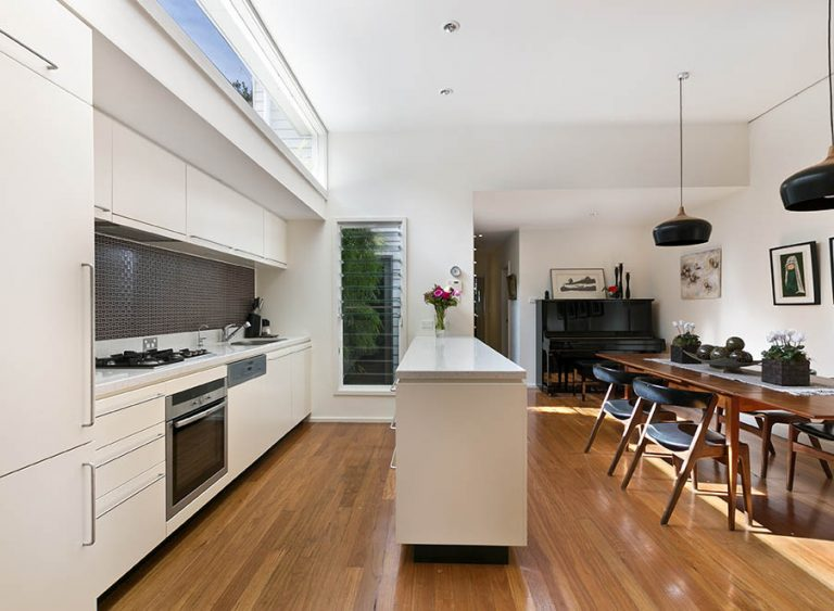 Property Improve Edinburgh open-plan kitchen with dining table and piano