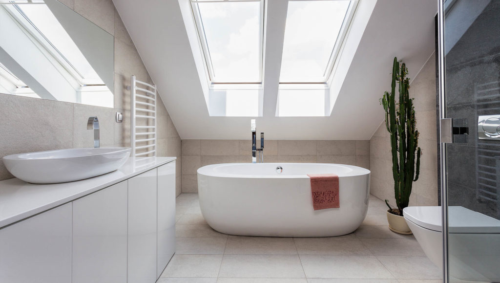 Modern bathroom with skylight and standing bath