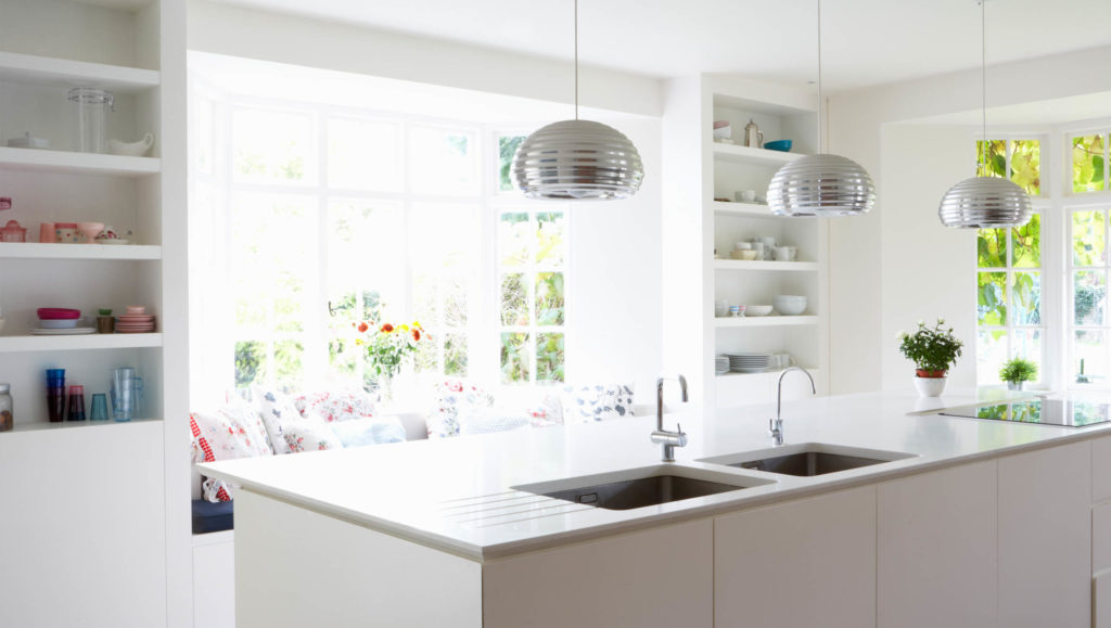 Modern kitchen with island counter featuring two sinks