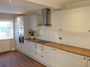 Traditional kitchen with wooden countertops and an electrical hob