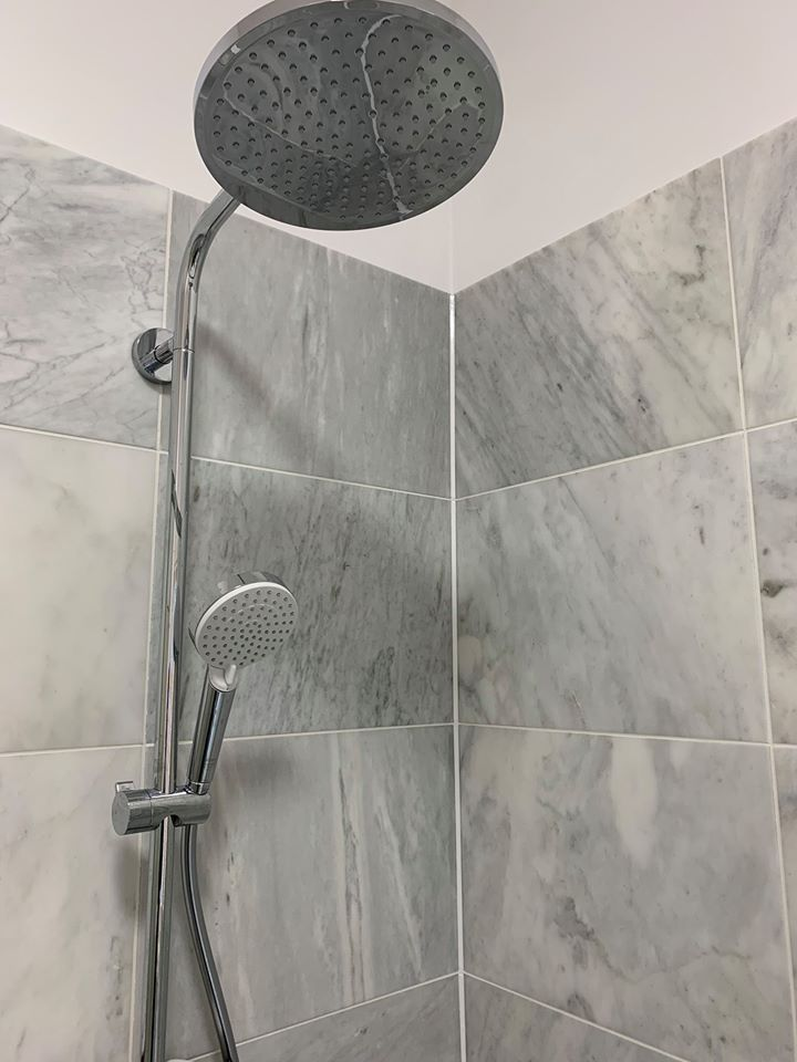 Close-up of rain shower and detachable shower head