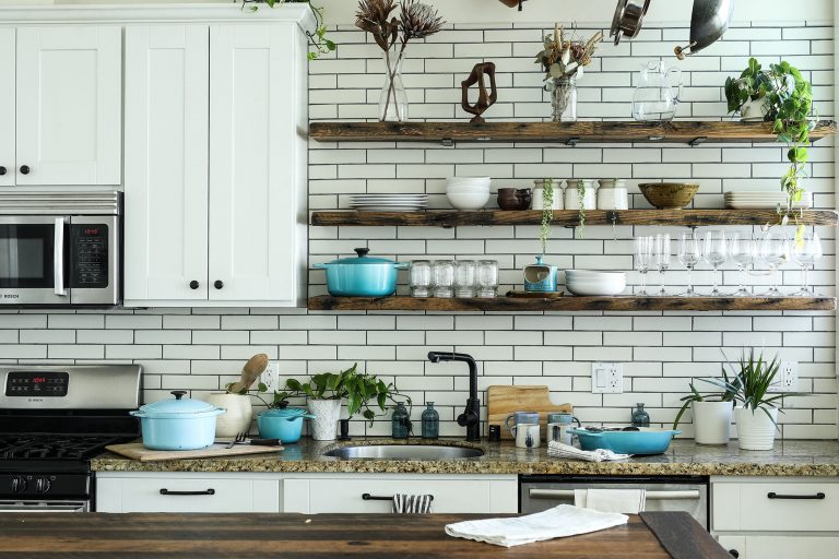 Kitchen with wooden shelves and white tiling