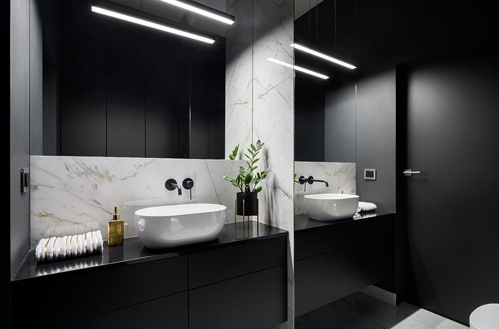 Modern black bathroom with white ceramics