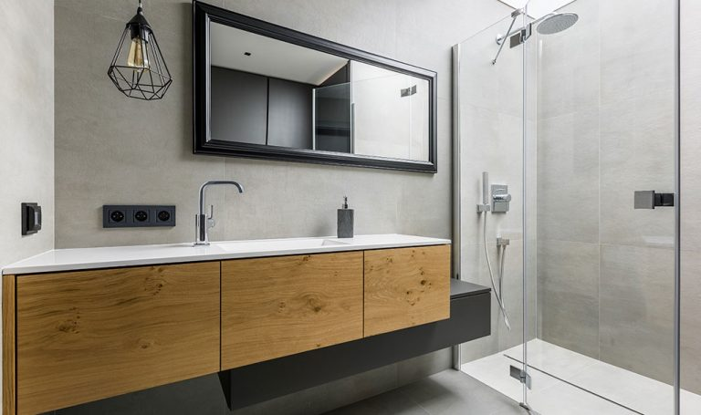 En-suite bathroom with shower cubicle and sink storage