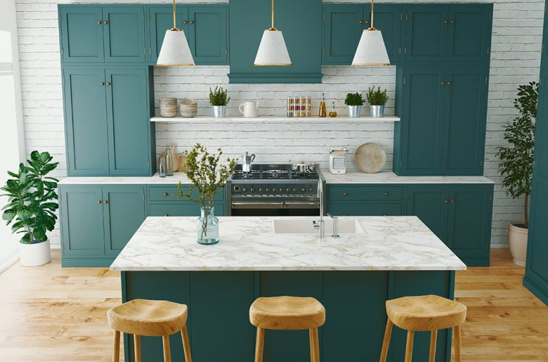 Modern kitchen with green cabinetry and an island