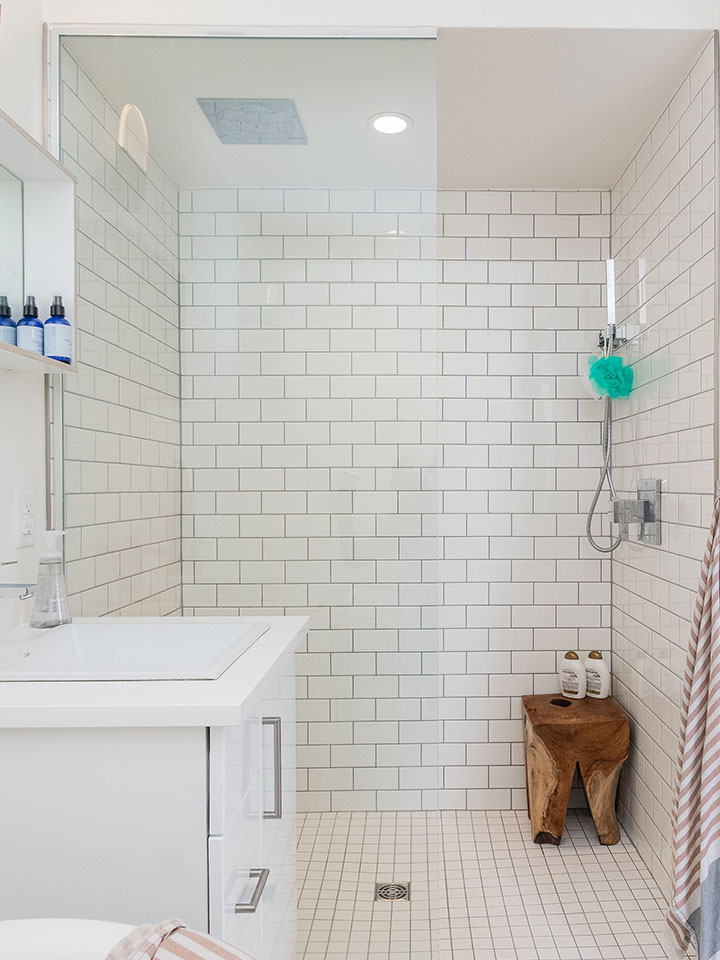 Shower cubicle with white tiling